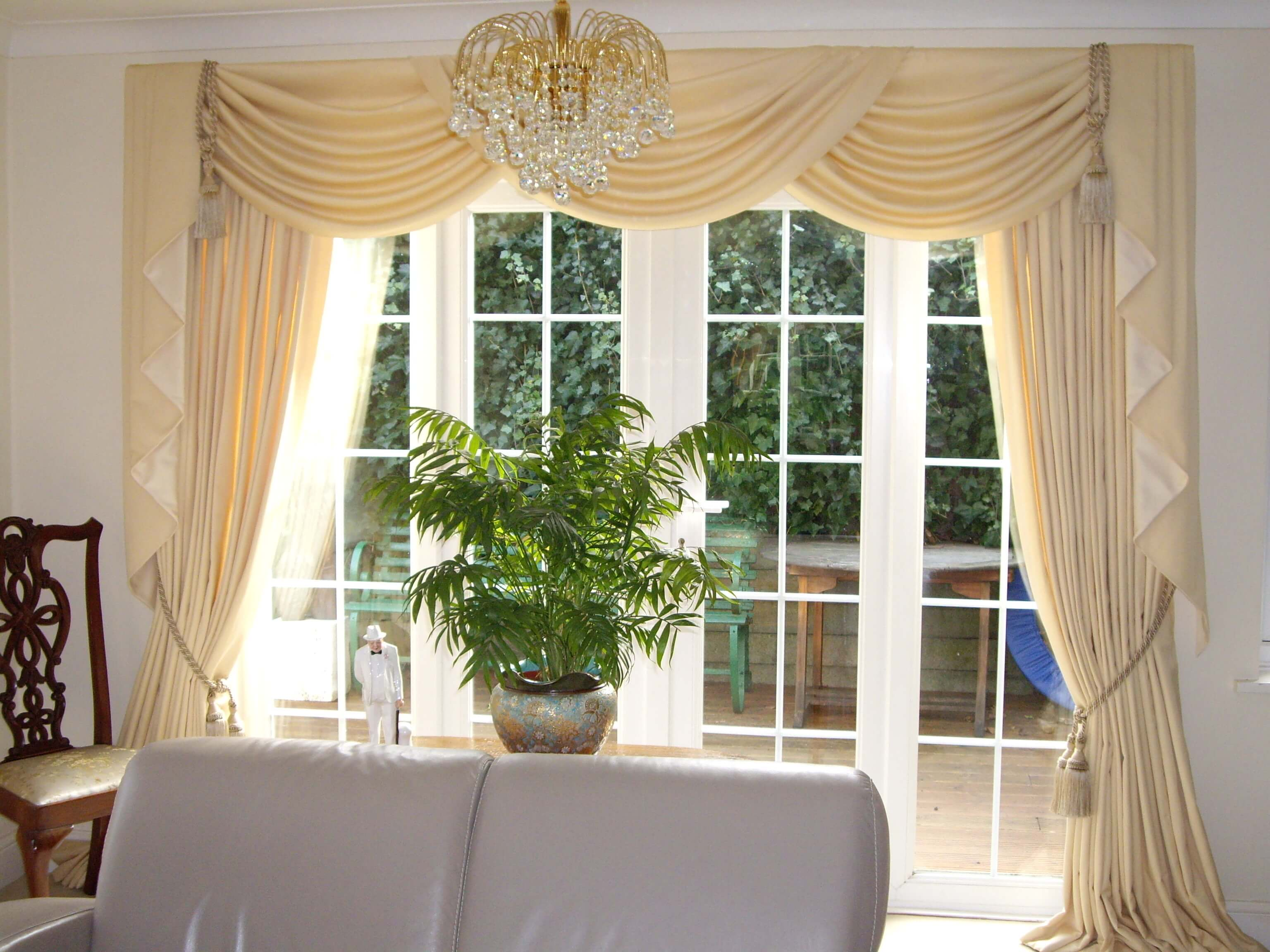Cream curtains with swags and tiebacks