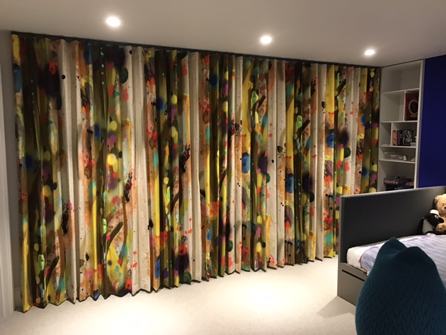 Closed bespoke wave curtains in colourful fabric