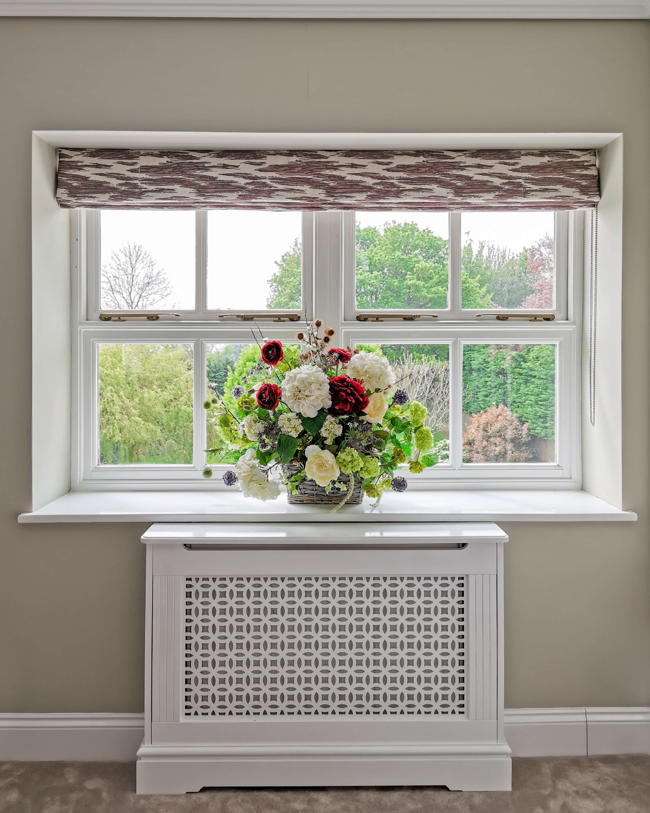 Patterned roman blind and flowers