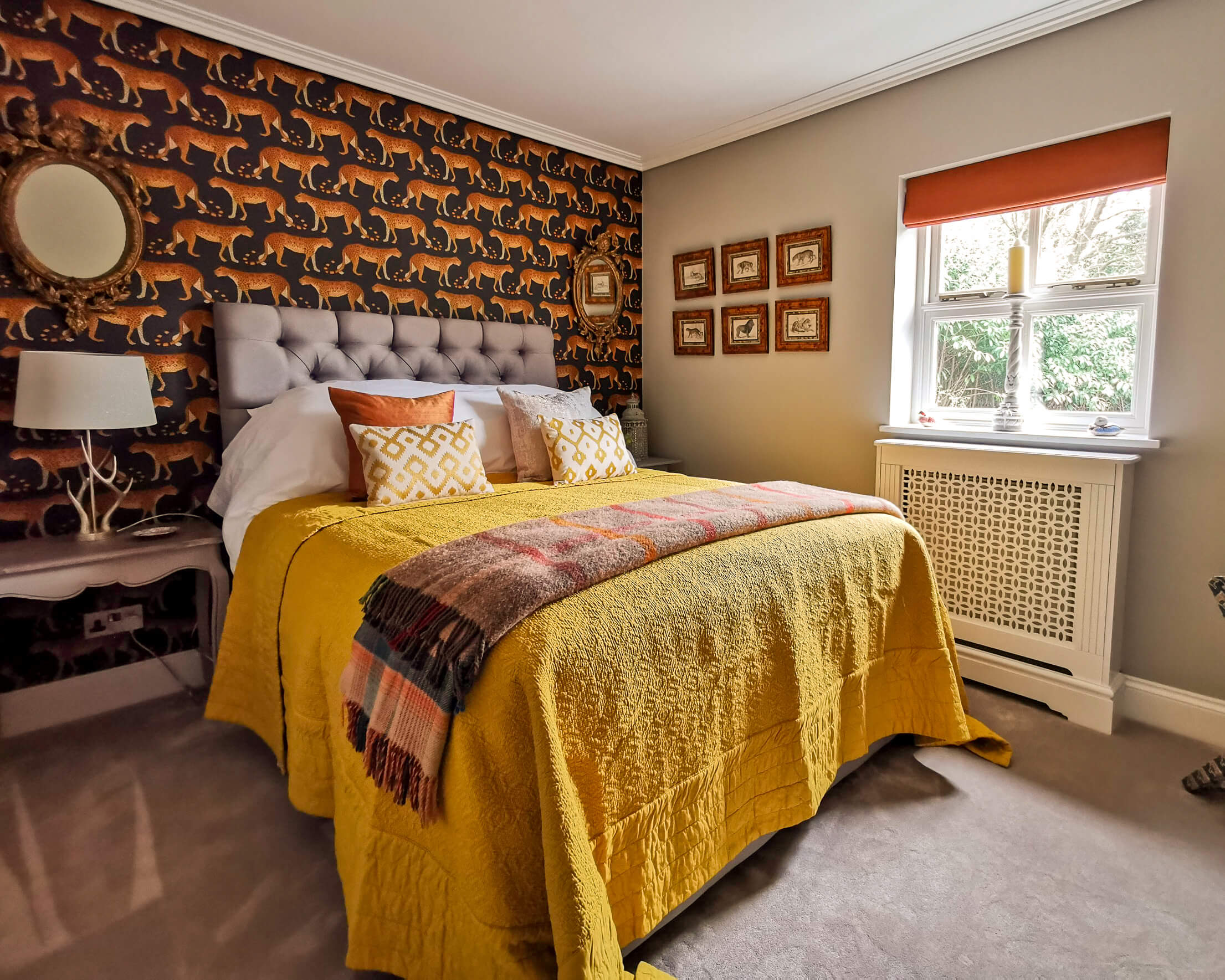 Orange roman blind and bed dressings
