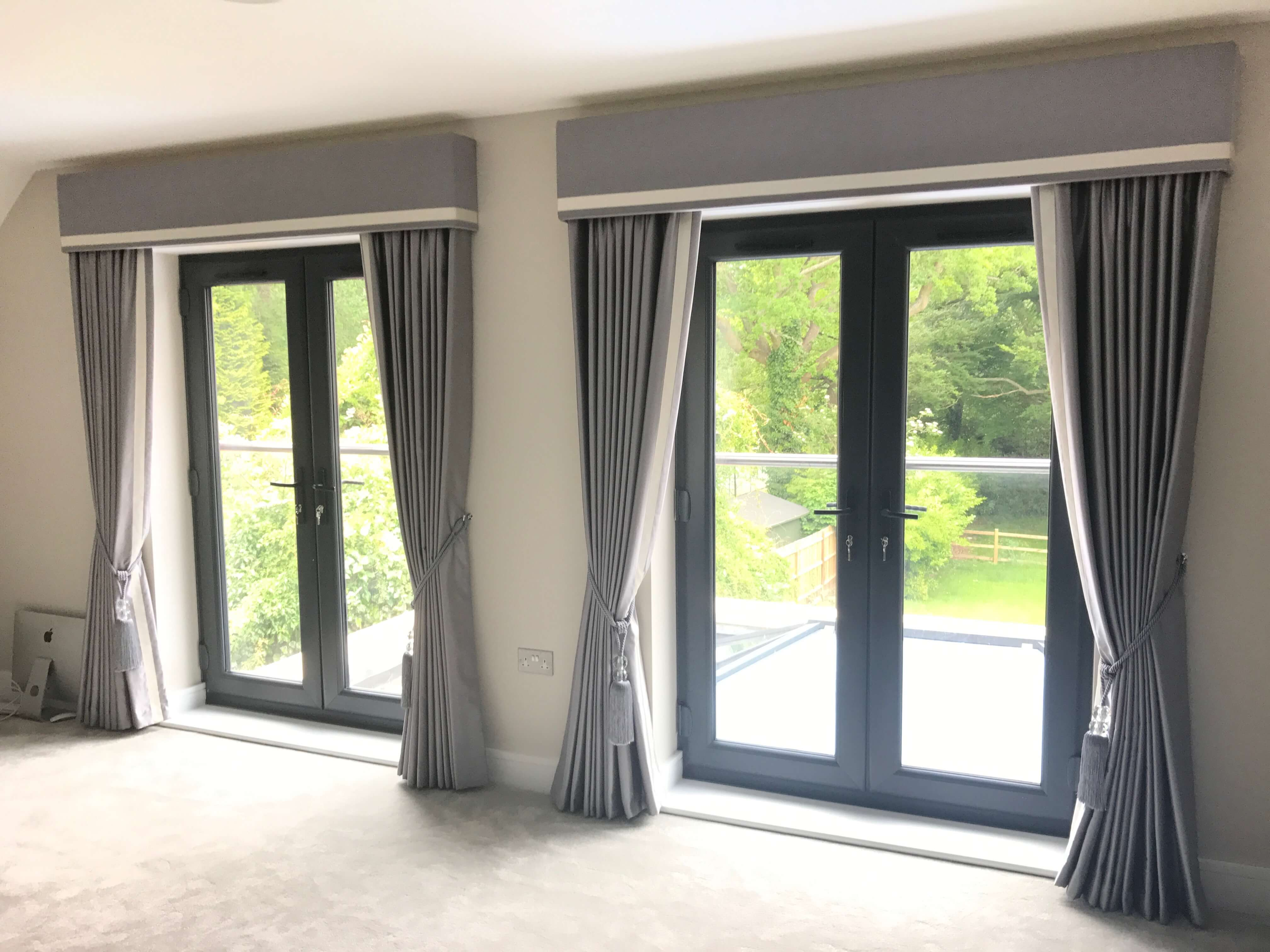 Grey bedroom curtains with box pelmets