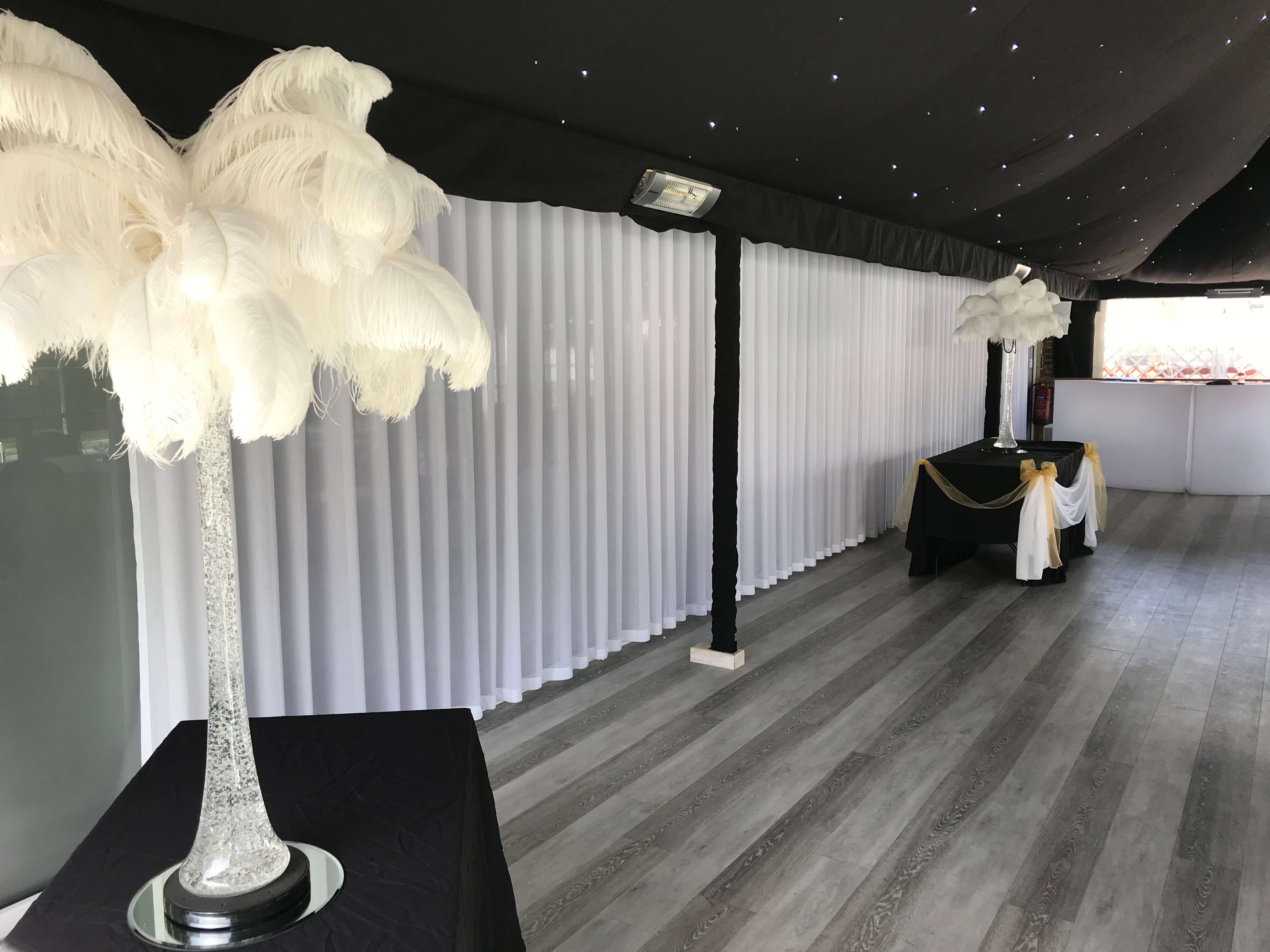 Bar with long white sheer wave curtain