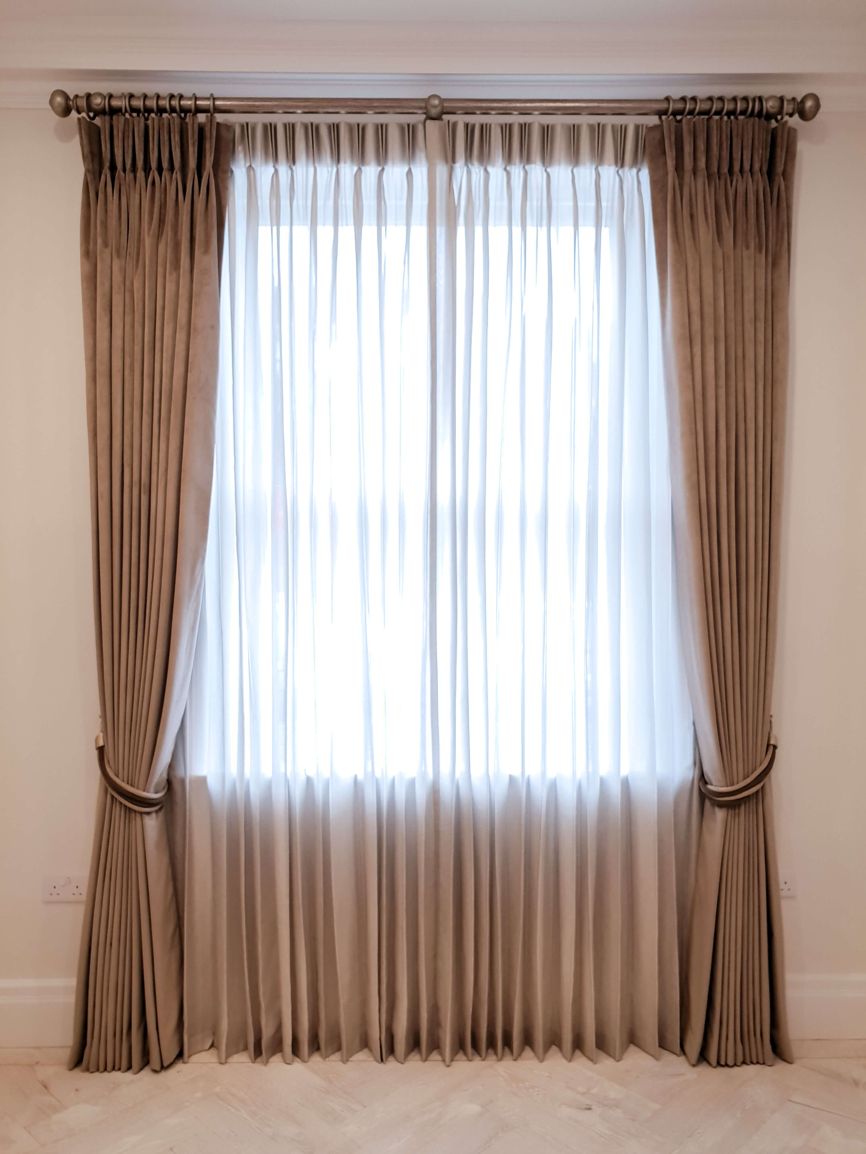 Curtains on a wooden pole with sheers