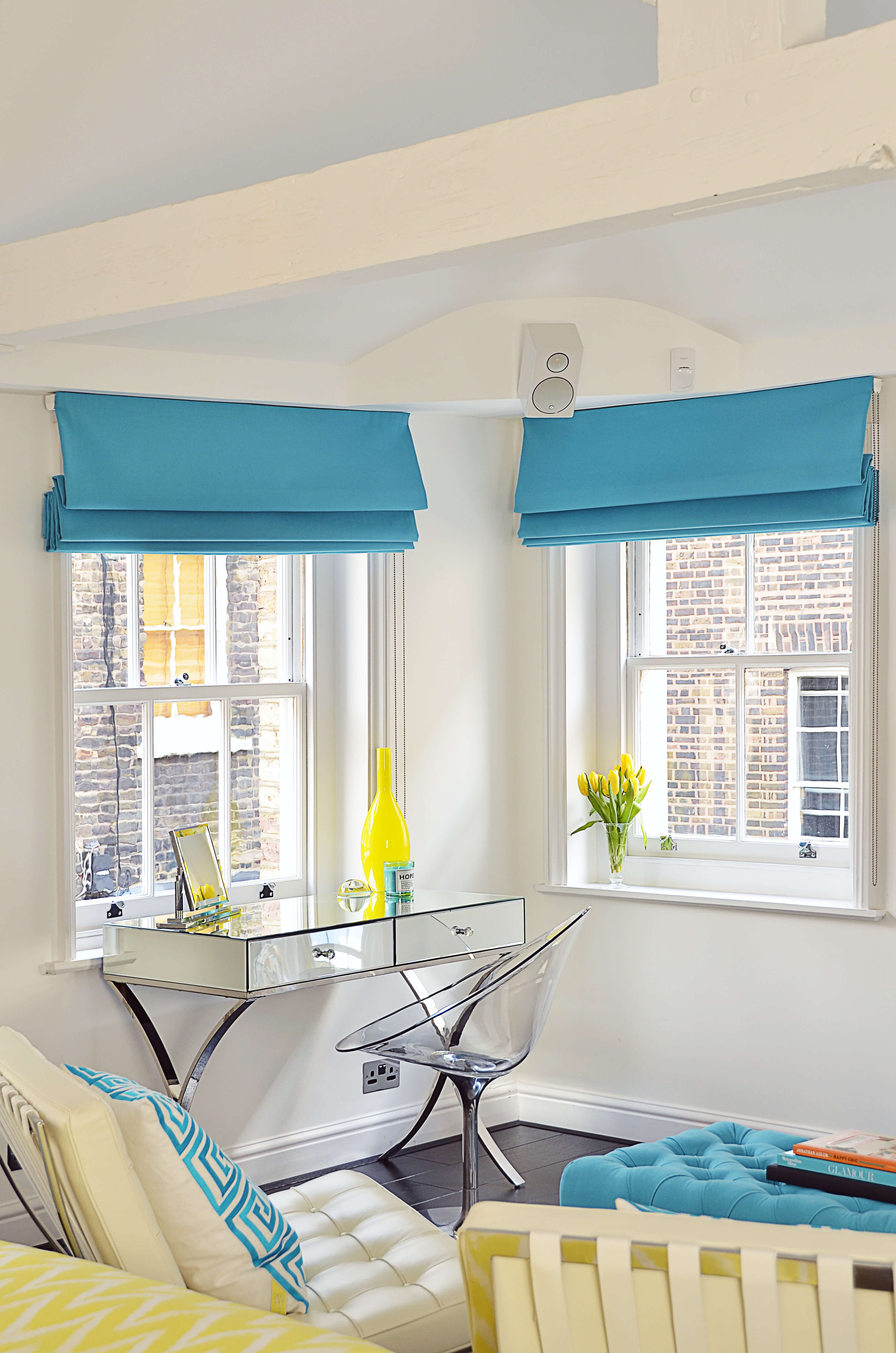 Blue roman blinds in loft space
