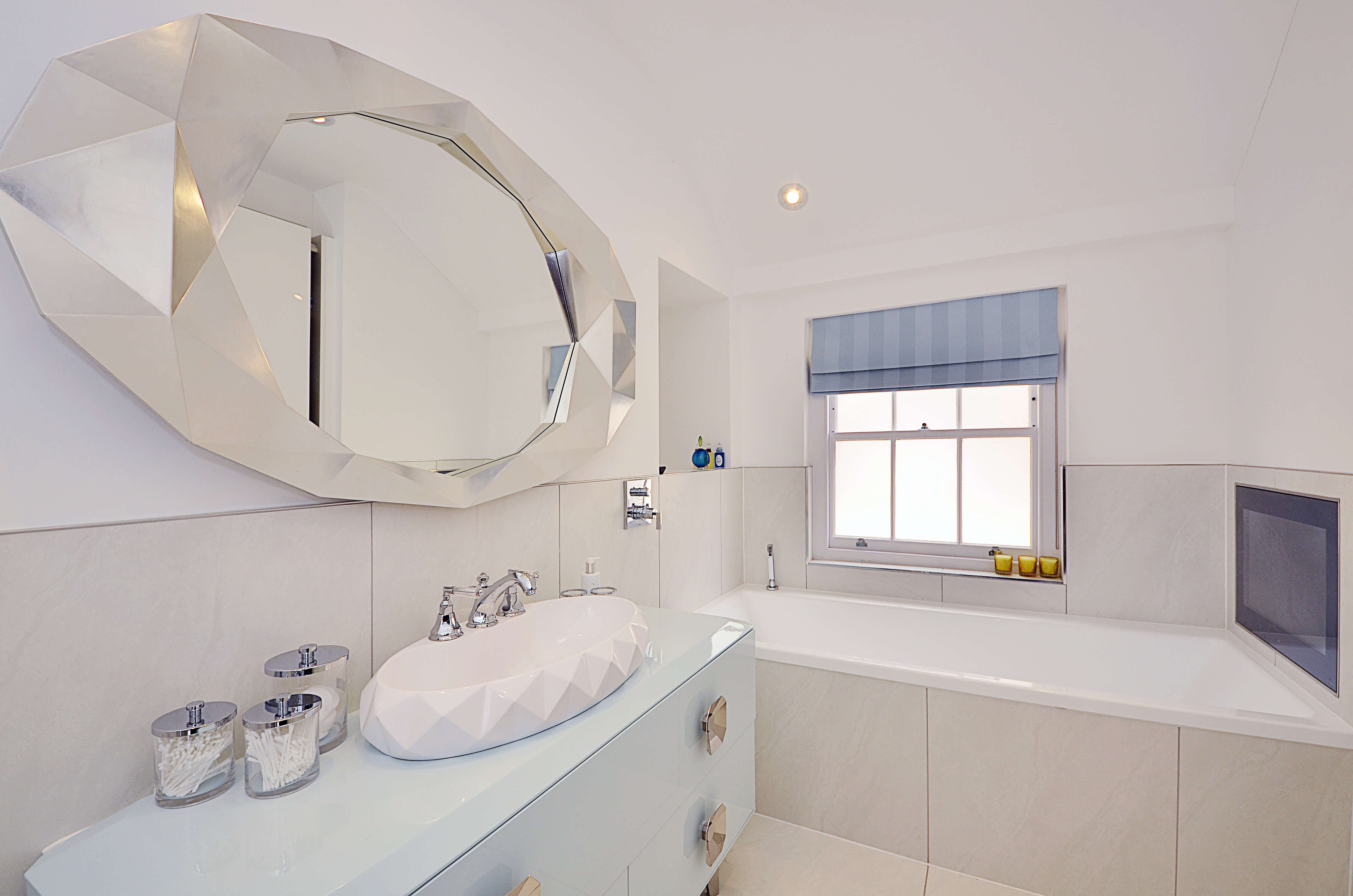 Bathroom with blue roman blind