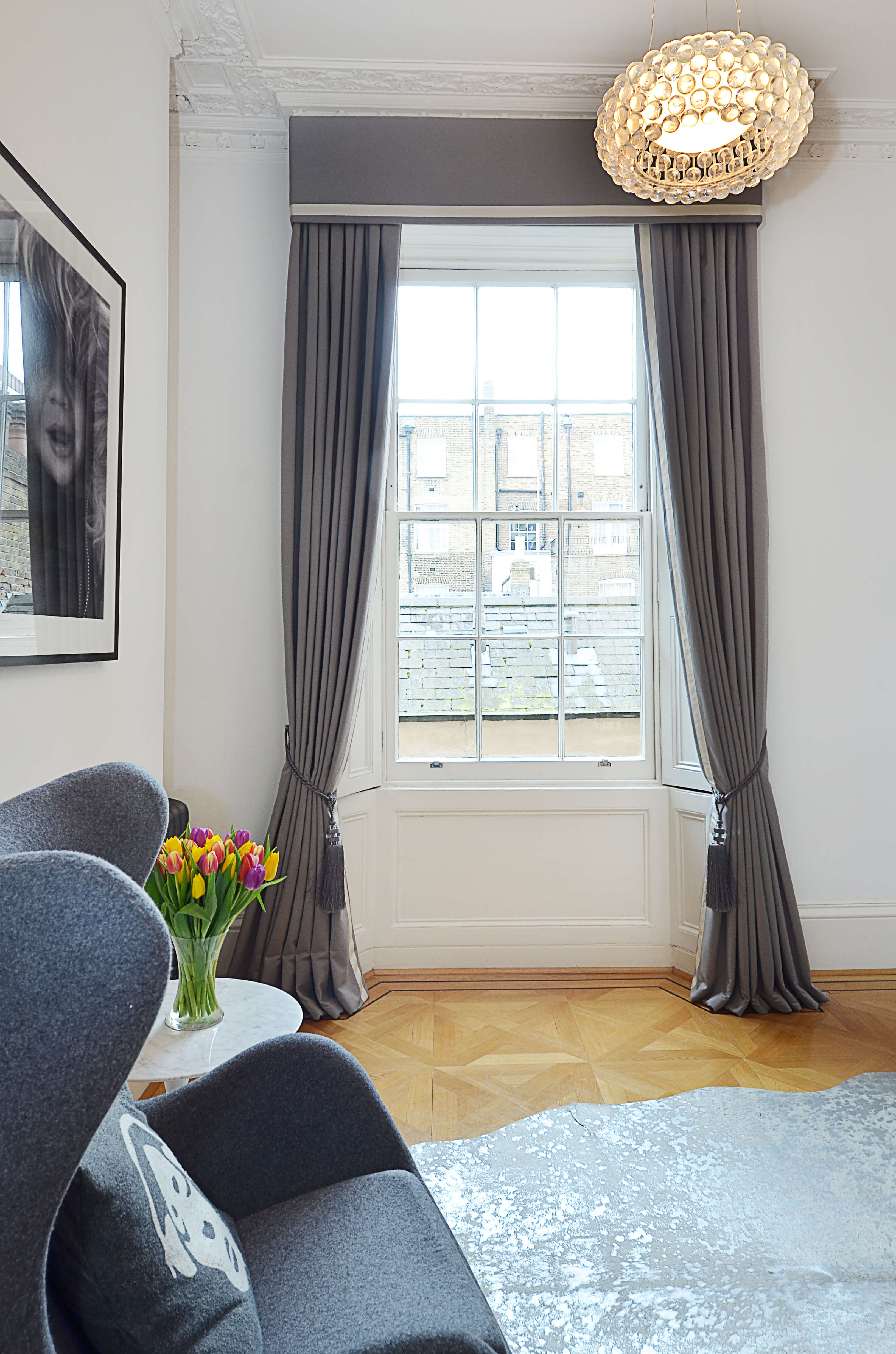 Grey bordered curtains with box pelmet and tiebacks