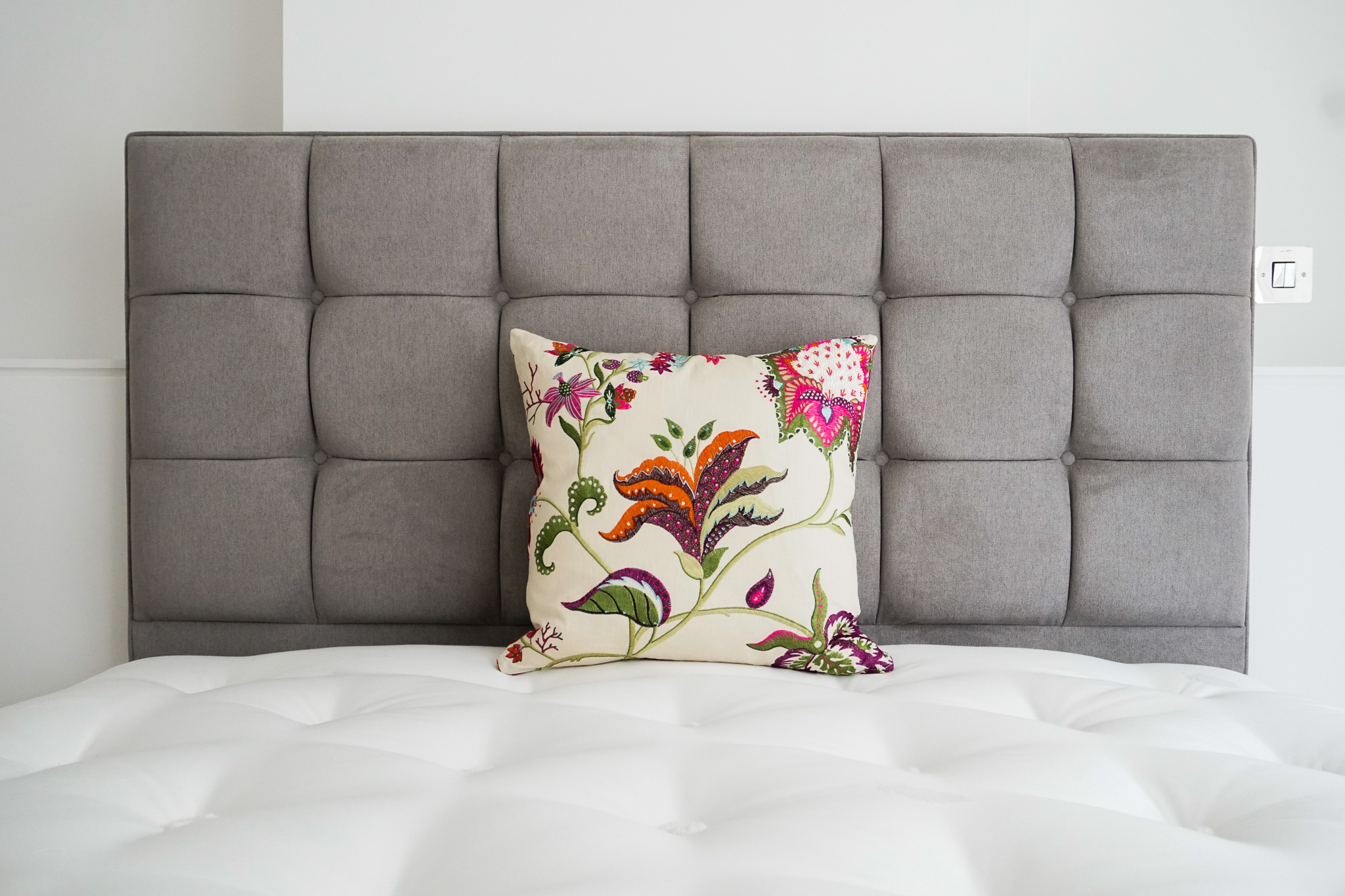 Bespoke upholstered cushion against headboard