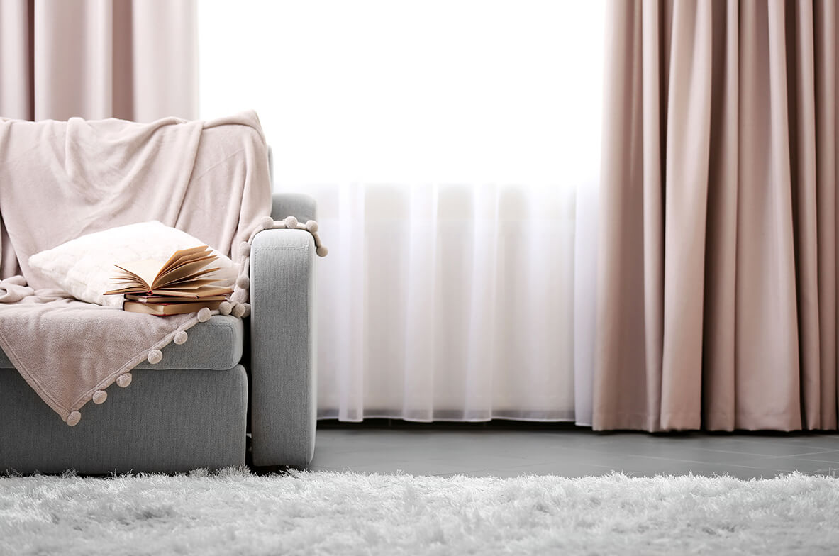 Soft pink wave curtains and sofa dressing